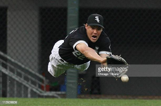 Chicago White Sox left fielder Scott Podsednik is unable to reach a hit by the Houston Astros' Chris Burke in the first inning at US Cellular Field...