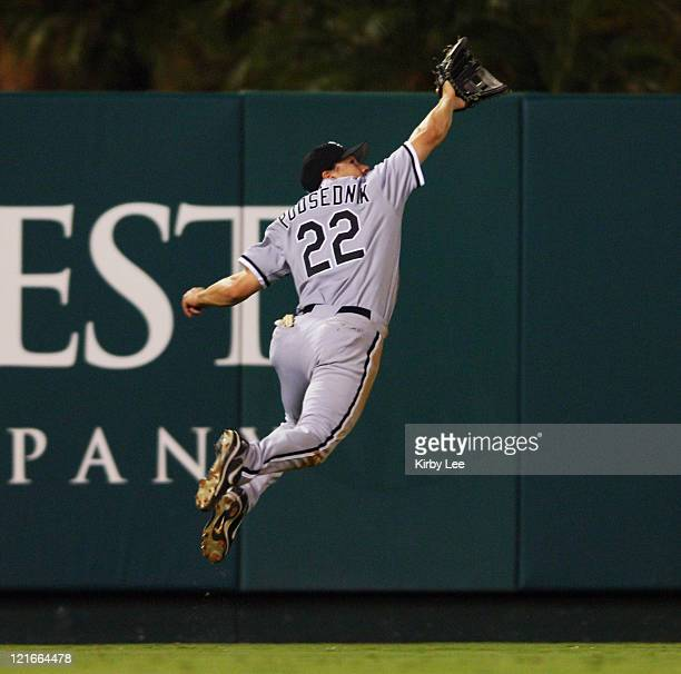 Chicago White Sox left fielder Scott Podsednik makes an unsuccessful leaping attempt at a fly ball by Orlando Cabrera of the Los Angeles Angels in...
