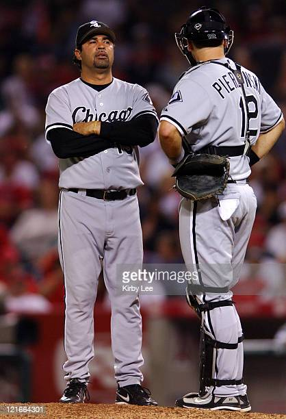 Chicago White Sox manager Ozzie Guillen and cacher AJ Pierzynski hold a meeting on the pitcher's mound during 43 loss in 11 innings to the Los...