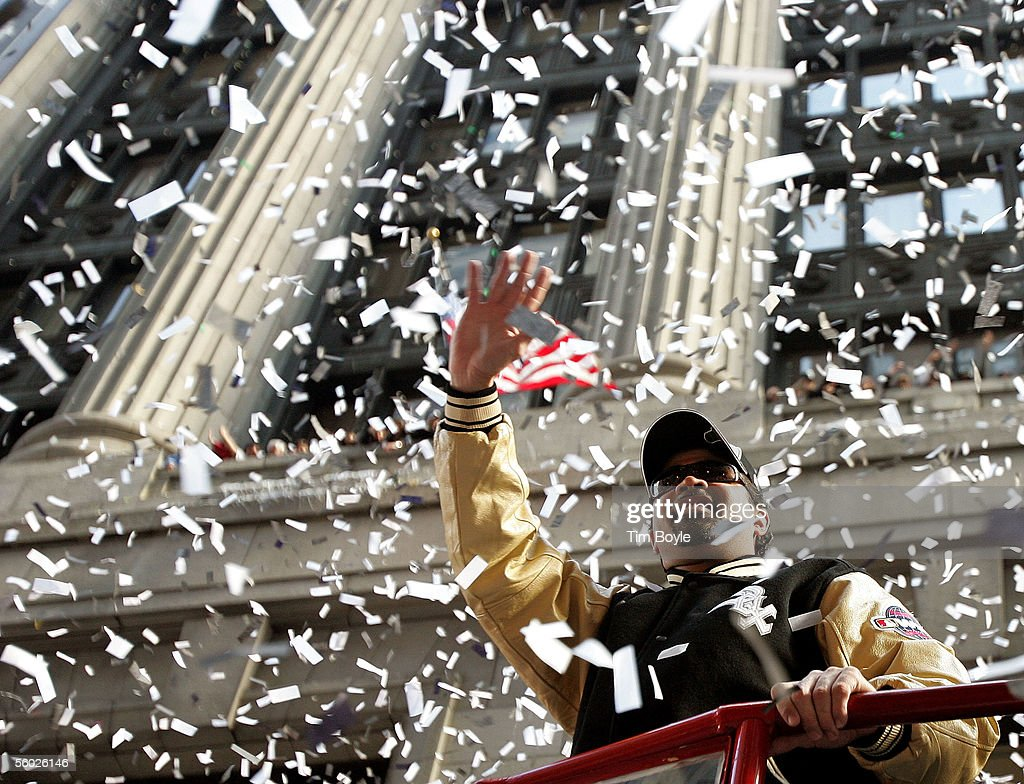 Chicago White Sox manager Ozzie Guillen waves to fans from a doubledecker bus during a tickertape parade for the White Sox baseball team October 28...