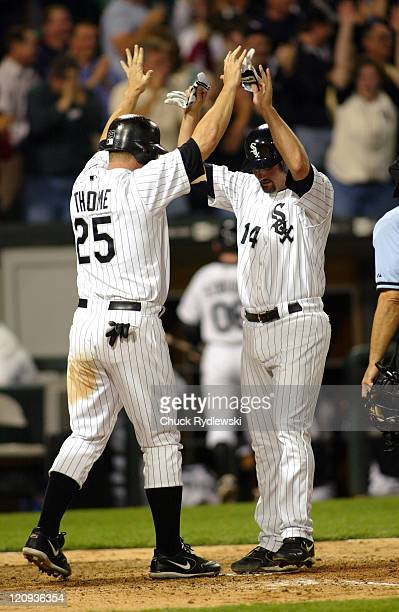 Chicago White Sox ' Paul Konerko and Jim Thome celebrate Joe Crede's 7th inning grand slam homer during their game against the Seattle Mariners May 3...