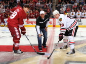 Chicago White Sox pitcher AJ Pierzynski drops the puck for team captains Shane Doan of the Phoenix Coyotes and Jonathan Toews of the Chicago...