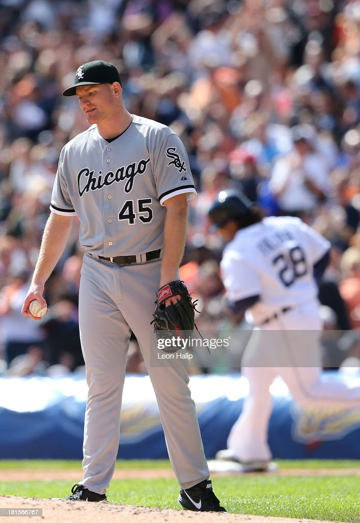 Chicago White Sox pitcher <a gi-track='captionPersonalityLinkClicked' href=/galleries/search?phrase=Erik+Johnson+-+Baseball+Player&family=editorial&specificpeople=12964257 ng-click='$event.stopPropagation()'>Erik Johnson</a> #45 reacts after giving up a solo home run to <a gi-track='captionPersonalityLinkClicked' href=/galleries/search?phrase=Prince+Fielder&family=editorial&specificpeople=209392 ng-click='$event.stopPropagation()'>Prince Fielder</a> #28 of the Detroit Tigers in the fourth inning of the game at Comerica Park on September 22, 2013 in Detroit, Michigan.