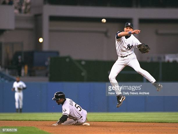 Chicago White Sox' Ray Durham is out at second as Yankees' shortstop Derek Jeter throws to first to complete a double play in the first inning of...