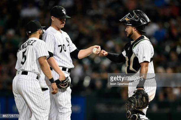 Chicago White Sox relief pitcher Aaron Bummer shakes hands with Chicago White Sox catcher Omar Narvaez before being relived during the game between...