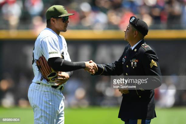 Chicago White Sox right fielder Avisail Garcia shakes hands with a member of the military prior to a game between the Chicago White Sox and the...