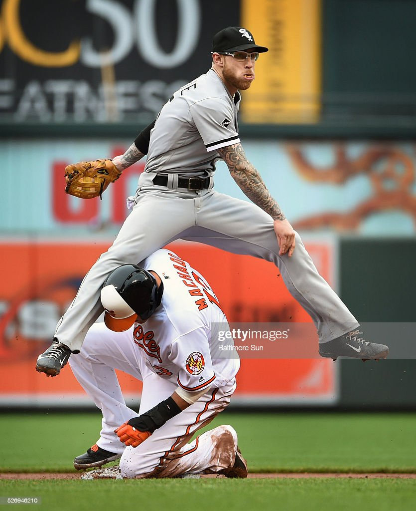 Chicago White Sox second baseman Brett Lawrie lands on a sliding Manny Machado, of the Baltimore Orioles, after throwing to first to double up Adam Jones to end the third inning on Sunday, May 1, 2016, at Oriole Park at Camden Yards in Baltimore.