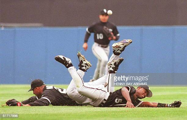 Chicago White Sox second baseman Ray Durham and right fielder Lyle Mouton slide along the grass after chasing a pop fly off the bat of the New York...