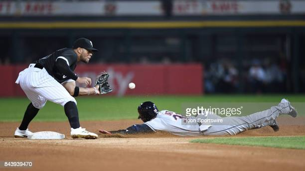 Chicago White Sox second baseman Yoan Moncada attempts to tag out Cleveland Indians third baseman Yandy Diaz while stealing during a game between the...