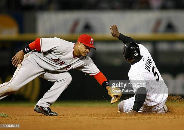 Chicago White Sox' Short stop Juan Uribe slides safely into 2nd base as Orlando Cabrera makes a late tag Uribe took second on a wild pitch during...