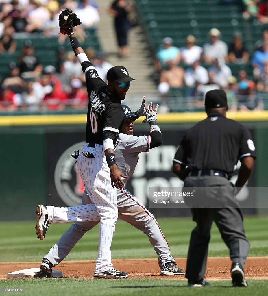 Chicago White Sox shortstop Alexei Ramirez (10) and Atlanta Braves baserunner Jose Constanza (13) react after Constanza was caught stealing in the first inning at U.S. Cellular Field in Chicago, illinois, Saturday, July 20, 2013. The White Sox defeated the Braves, 10-6.