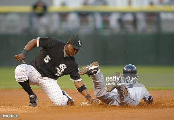 Chicago White Sox Shortstop Juan Uribe puts the tag on Seattle Mariners Jeremy Reed who was attempting to steal second base during a game at US...