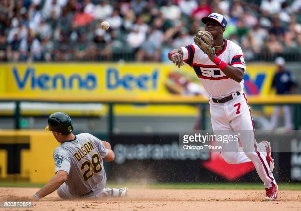Chicago White Sox shortstop Tim Anderson forces out Oakland Athletics right fielder Matt Olson but can't complete the double play in the seventh...