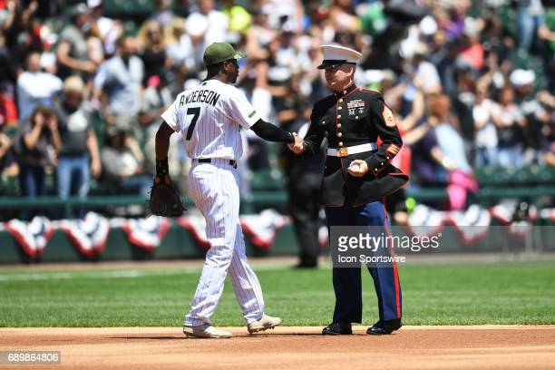 Chicago White Sox shortstop Tim Anderson shakes hands with a member of the military prior to a game between the Chicago White Sox and the Boston Red...