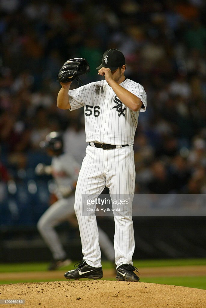 Chicago White Sox starter, Mark Buehrle, tugs at his cap as Aaron Boone circles the bases after hitting a 2-run homer during the game against the Cleveland Indians September 20, 2005 at U.S. Cellular Field in Chicago, Illinois. The Indians and White Sox were tied 3-3 in the 5th inning.