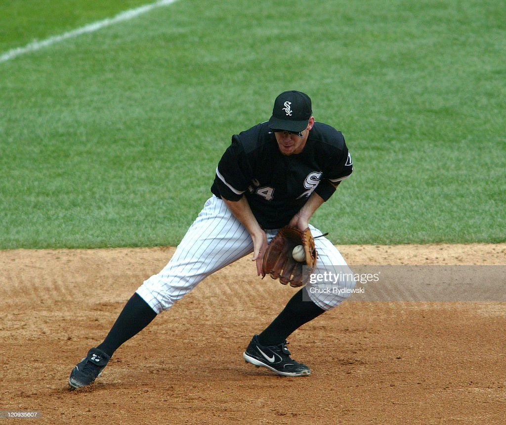 Chicago White Sox' third baseman, Joe Crede, makes a catch of a ground ball during their game against the Minnesota Twins August 27, 2006 at U.S. Cellular Field in Chicago, Illinois. The White Sox defeated the Twins 6-1.