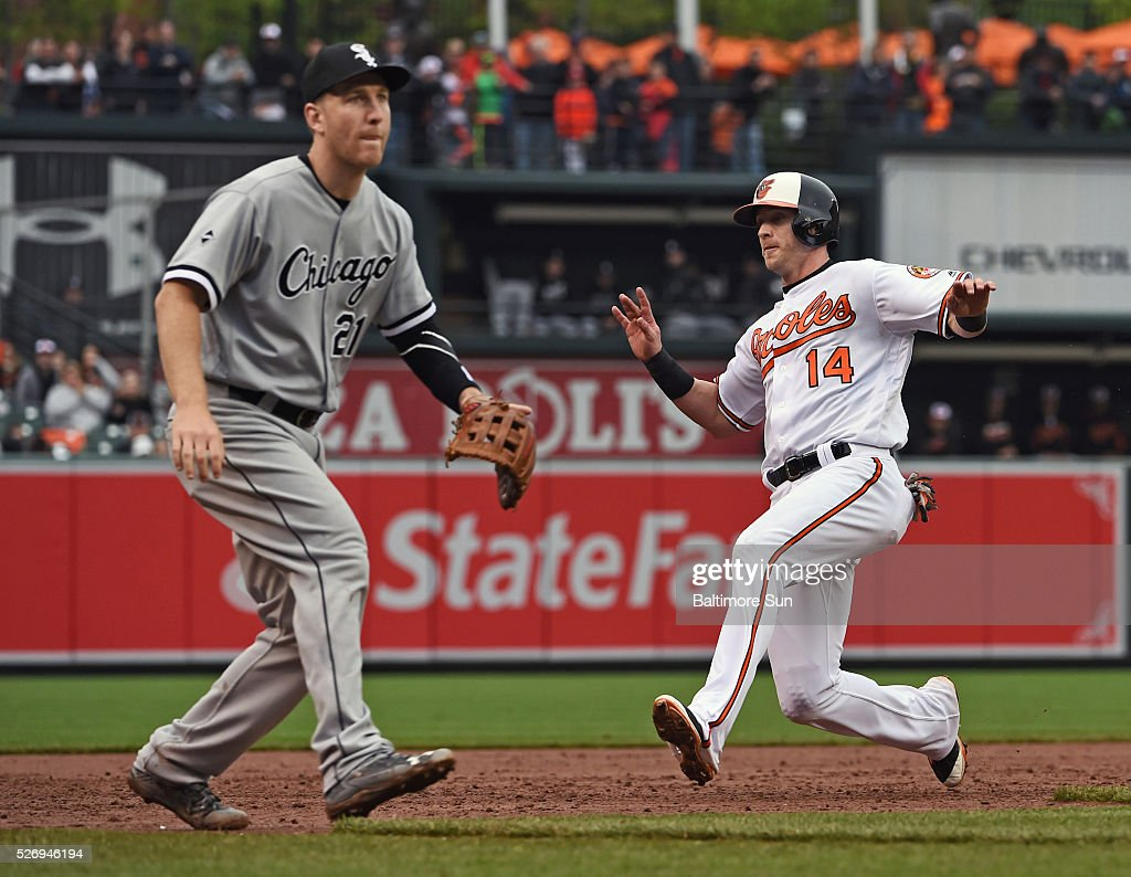 Chicago White Sox third baseman Todd Frazier waits for the ball as Baltimore Orioles' Nolan Reimold slides into third after a wild pitch by reliever Jake Petricka during the sixth inning on Sunday, May 1, 2016, at Oriole Park at Camden Yards in Baltimore.