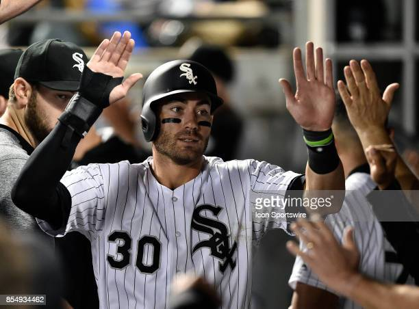 Chicago White Sox's Nicky Delmonico celebrates in the dugout with teammates after scoring on the sacrifice of Chicago White Sox's Willy Garcia during...