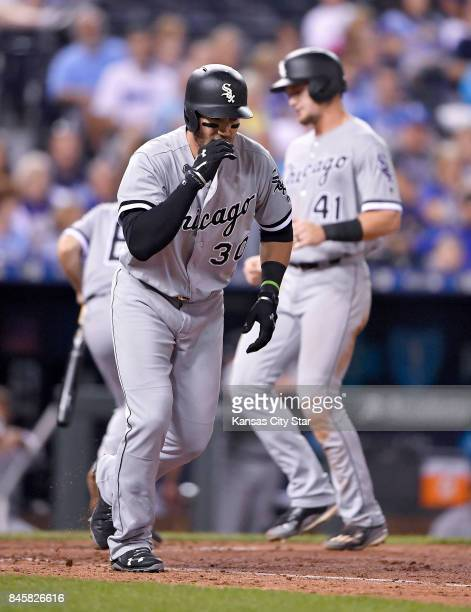 Chicago White Sox's Nicky Delmonico heads to first as Adam Engel scores on a bases loaded walk by Kansas City Royals starting pitcher Jason Hammel in...