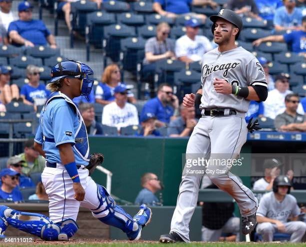 Chicago White Sox's Nicky Delmonico scores on a single by Tim Anderson in front of Kansas City Royals catcher Salvador Perez in the fourth inning on...