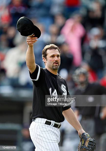 Chicago White Sox's Paul Konerko tips his hat to fans as he exits the game in the seventh inning against the Cleveland Indians at US Cellular Field...