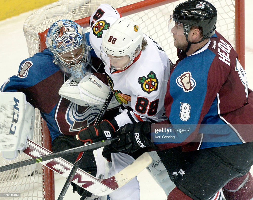 Chicago wing Patrick Kane (88) was sandwiched between Colorado goalie Semyon Varlamov and defenseman Jan Hejda in the second period. The Colorado Avalanche hosted the Chicago Blackhawks at the Pepsi Center Wednesday night, March 12, 2014 in Denver, Colorado.