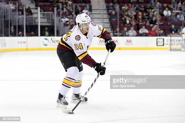 Chicago Wolves D Jordan Schmaltz shoots the puck during the first period of the AHL hockey game between the Chicago Wolves and and Cleveland Monsters...