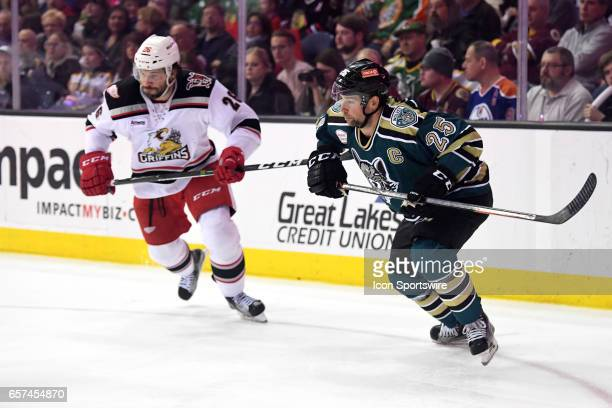 Chicago Wolves defenseman Chris Butler skates next to Grand Rapids Griffins left wing Eric Tangradi during an AHL hockey game between the Chicago...