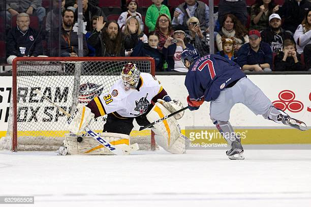 Chicago Wolves Pheonix Copley makes a save on Cleveland Monsters LW Nick Moutrey during the shootout of the AHL hockey game between the Chicago...