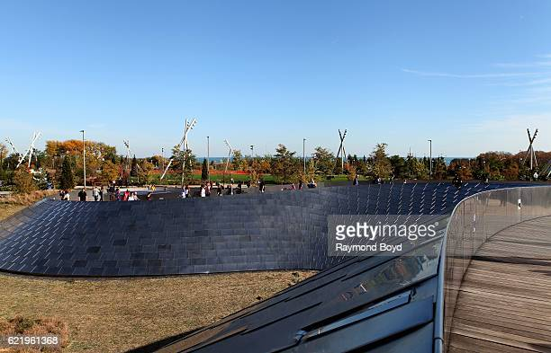 Chicagoans walk across the Frank Gehrydesigned BP Bridge into Maggie Daley Park in Chicago Illinois on November 5 2016