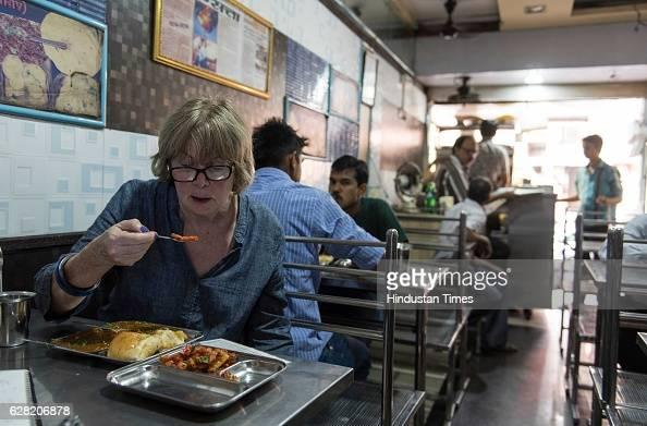 Chicagobased food historian and writer Colleen Taylor Sen tasting Pav Bhaji at Manohar Pav Bhaji Girgaum on November 18 2016 in Mumbai India Colleen...