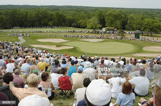 Chicagoland golf fans surround the 14th green during the final round of the Cialis Western Open July 3 2005 in Lemont Illinois