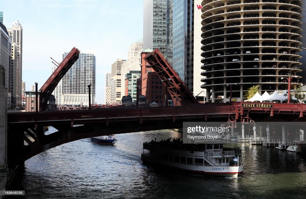 Chicago's iconic Wabash Avenue bridge lowers, and the Dearborn Street bridge raises for boats to pass through in Chicago, Illinois on SEPTEMBER