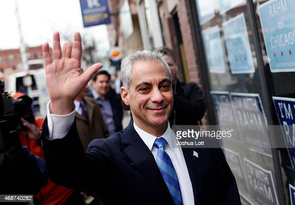 Chicago's mayor and candidate for reelection Rahm Emanuel waves to supporters as he walks to his campaign office April 6 2015 in Chicago Illinois...