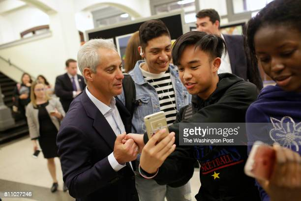Chicago's Mayor Rahm Emanuel left takes a selfie with a students at Senn High School Wednesday May 10 2017 in Chicago Illinois Mayor Emanuel is...