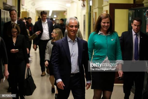 Chicago's Mayor Rahm Emanuel left walks with Senn High School Principal Mary Beck center Wednesday May 10 2017 in Chicago Illinois Mayor Emanuel is...