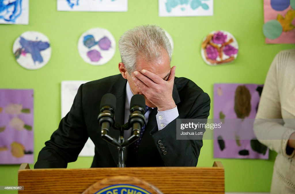 Chicago's Mayor Rahm Emanuel places his hand over his face as he laughs at his own joke during a news conference at Carole Robertson Center for Learning April 8, 2015 in Chicago, Illinois. Emanuel was elected to his second term as mayor after defeating Cook County Commissioner Jesus 'Chuy' Garcia in a runoff election.