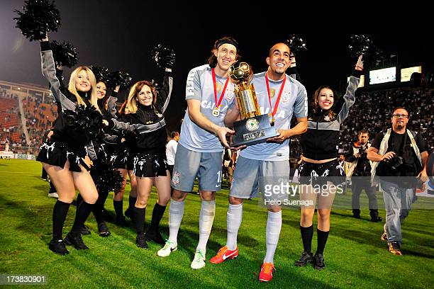 Chicao and Cassio of Corinthians celebrate the title of South American Recopa 2013 during the match between Corinthians and Sao Paulo for the Recopa...
