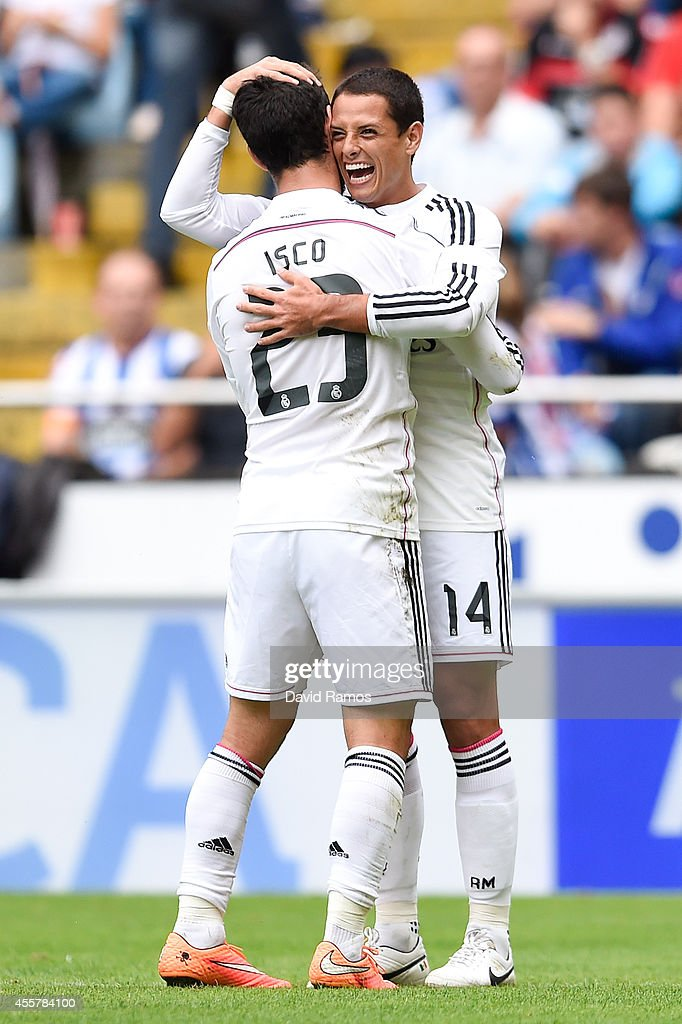 Chicharito Hernandez of Real Madrid CF celebrates with his teammate Francisco Alarcon <a gi-track='captionPersonalityLinkClicked' href=/galleries/search?phrase=Isco&family=editorial&specificpeople=5848609 ng-click='$event.stopPropagation()'>Isco</a> after scoring his team's seventh goal during the La Liga match between RC Deportivo La Coruna and Real Madrid CF at Riazor Stadium on September 20, 2014 in La Coruna, Spain.