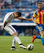 Chicharito Hernandez of Real Madrid shoots on goal during the La Liga match between Real Madrid and Valencia at Estadio Santiago Bernabeu on May 9...