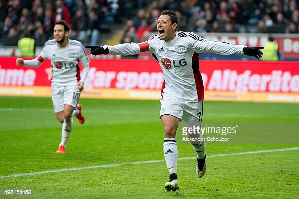 Chicharito of Bayer Leverkusen celebrates the first goal for his team with Hakan Calhanoglu of Bayer Leverkusen during the Bundesliga match between...