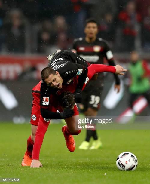 Chicharito of Bayer Leverkusen is challenged by Bastian Oczipka of Frankfurt during the Bundesliga match between Bayer 04 Leverkusen and Eintracht...