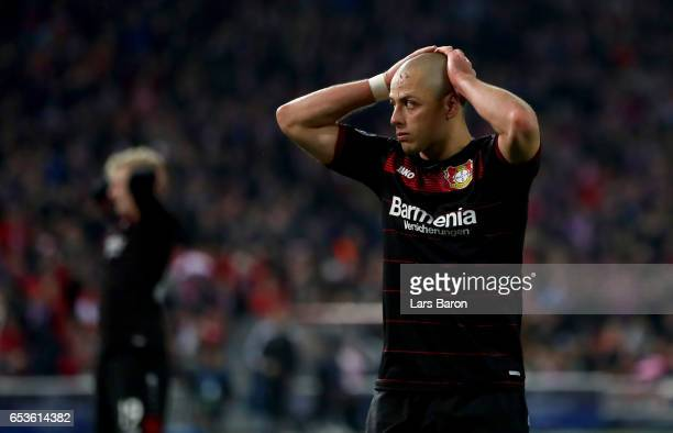 Chicharito of Bayer Leverkusen reacts during the UEFA Champions League Round of 16 second leg match between Club Atletico de Madrid and Bayer...