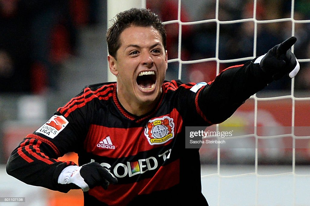 Chicharito of Leverkusen celebrates after scoring his team's fifth goal during the Bundesliga match between Bayer Leverkusen and Borussia Moenchengladbach at BayArena on December 12, 2015 in Leverkusen, Germany.