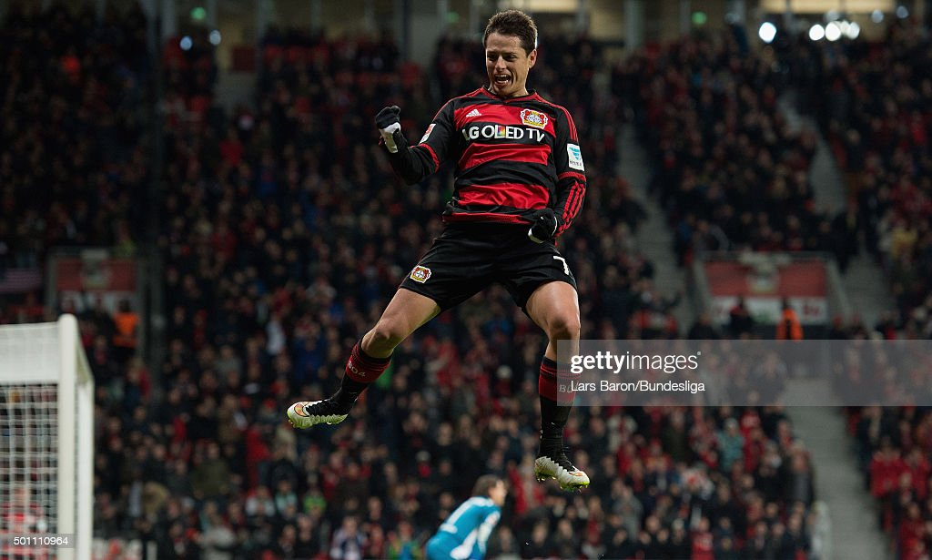 Chicharito of Leverkusen celebrates after scoring his teams fourth goal during the Bundesliga match between Bayer Leverkusen and Borussia Moenchengladbach at BayArena on December 12, 2015 in Leverkusen, Germany.