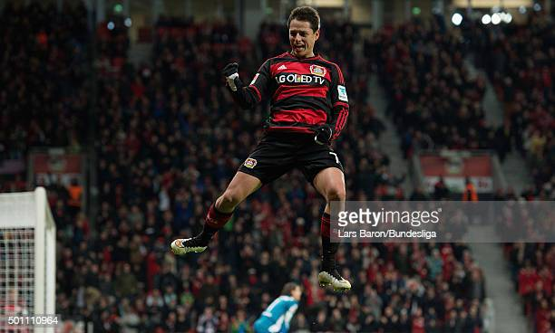 Chicharito of Leverkusen celebrates after scoring his teams fourth goal during the Bundesliga match between Bayer Leverkusen and Borussia...