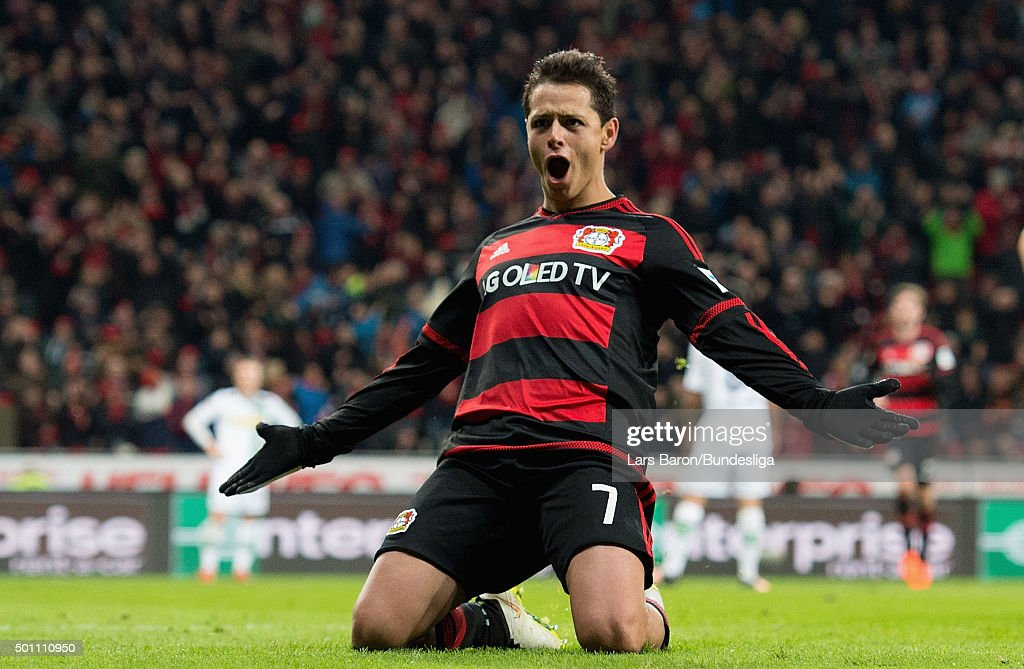 Chicharito of Leverkusen celebrates after scoring his teams second goal during the Bundesliga match between Bayer Leverkusen and Borussia Moenchengladbach at BayArena on December 12, 2015 in Leverkusen, Germany.