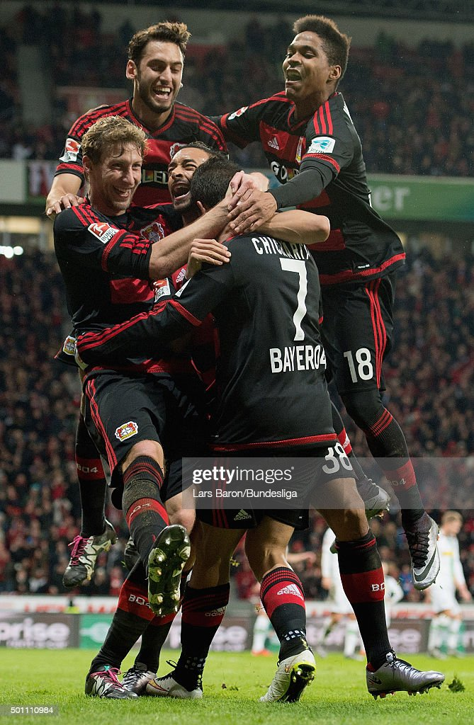 Chicharito of Leverkusen celebrates with team mates after scoring his teams second goal during the Bundesliga match between Bayer Leverkusen and Borussia Moenchengladbach at BayArena on December 12, 2015 in Leverkusen, Germany.