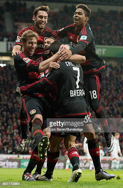 Chicharito of Leverkusen celebrates with team mates after scoring his teams second goal during the Bundesliga match between Bayer Leverkusen and...