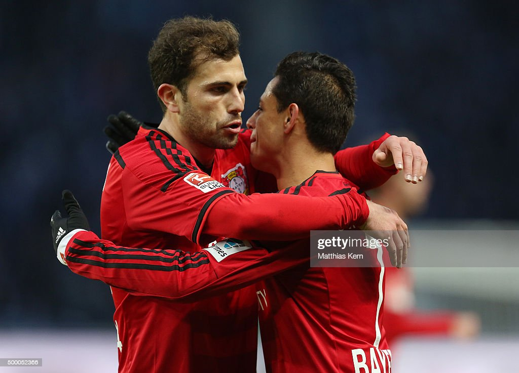 Chicharito (R) of Leverkusen jubilates with team mate Admir Mehmedi (L) after scoring the second goal during the Bundesliga match between Hertha BSC and Bayer Leverkusen at Olympiastadion on December 5, 2015 in Berlin, Germany.